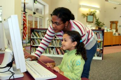 teacher helping little girl