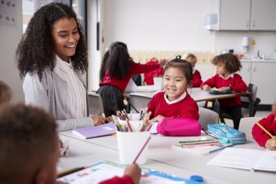 teacher and little girl smiling
