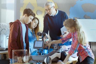 children looking at robotics project